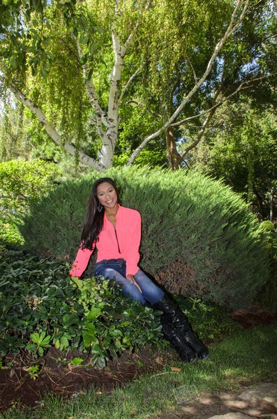 Daisha, High School Senior Sitting In Bush