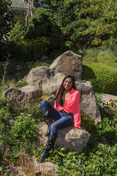 Daisha, High School Senior Sitting in a Rock Garden